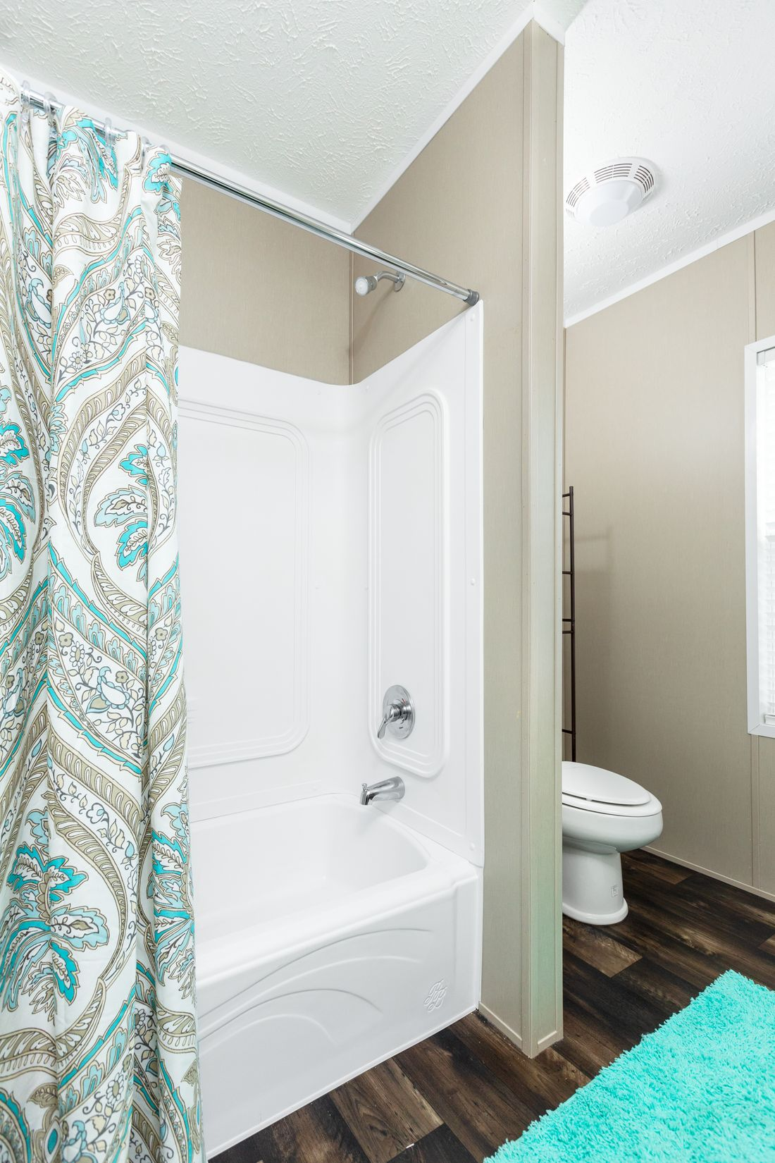 The ISLAND BREEZE 56' Guest Bathroom. This Manufactured Mobile Home features 3 bedrooms and 2 baths.