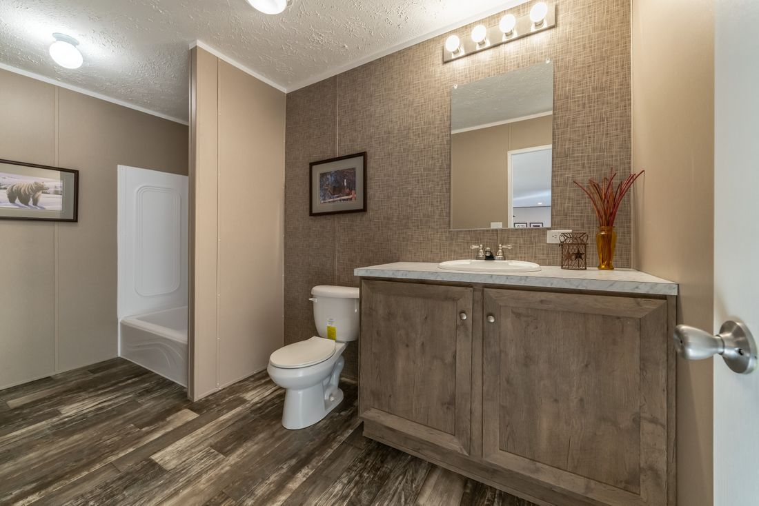 The ULTRA PRO 56B Guest Bathroom. This Manufactured Mobile Home features 3 bedrooms and 2 baths.