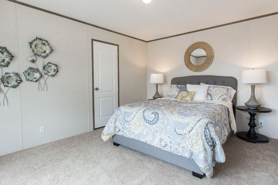 The THE NEW BREEZE I Master Bedroom. This Manufactured Mobile Home features 3 bedrooms and 2 baths.