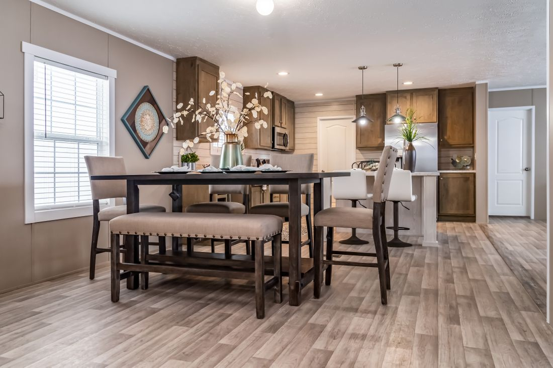 The ULTRA PRO 72 Dining Area. This Manufactured Mobile Home features 4 bedrooms and 2 baths.